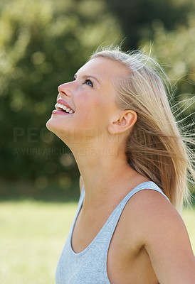 Buy stock photo Side view of happy attractive female looking up outdoors