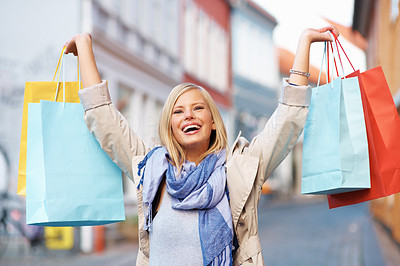Buy stock photo Excited young woman with her shopping bags
