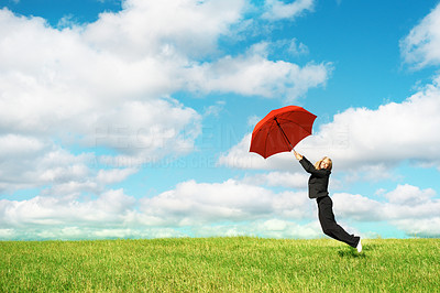 Buy stock photo Portrait of business woman jumping with red umbrella against blue sky