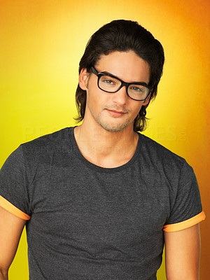Buy stock photo Attractive man wearing glasses and standing against yellow background