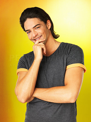 Buy stock photo Flirtatious man casually posing with hand on chin