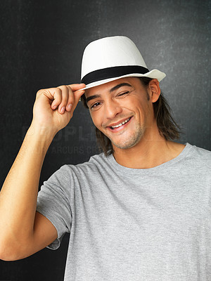 Buy stock photo Flirtatious man against gray background wearing hat
