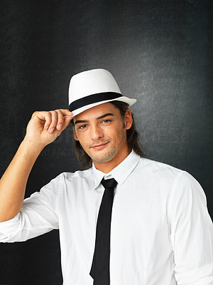 Buy stock photo Man against gray background holding brim of hat