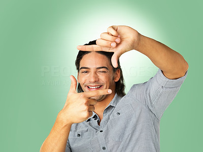 Buy stock photo Smiling man looking through frame created with his hands