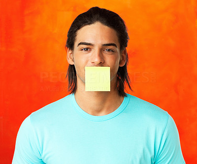 Buy stock photo Attractive young man with adhesive note over his mouth