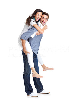 Buy stock photo Portrait of a happy young man giving a piggyback ride to her girlfriend against white background