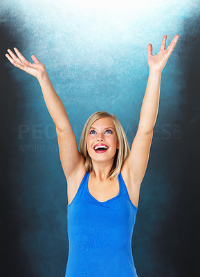 Buy stock photo Portrait of young woman with arms raised up