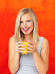Happy woman sipping orange juice