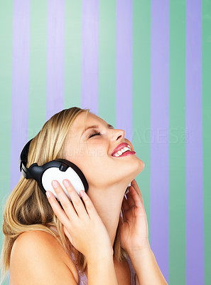 Buy stock photo Pretty young woman listening to music