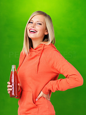 Buy stock photo Smiling woman holding cola on green background
