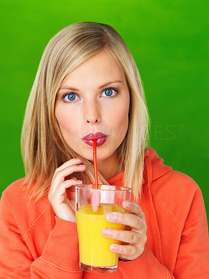 Buy stock photo Closeup of pretty woman sipping juice on green background