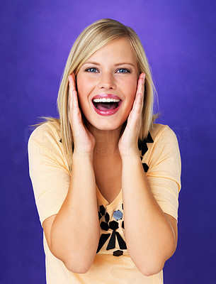 Buy stock photo Excited young woman with hands on face