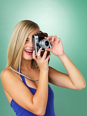 Buy stock photo Young woman focusing lens on vintage camera