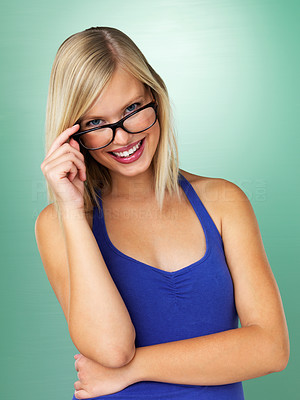 Buy stock photo Woman holding glasses while smiling on green background