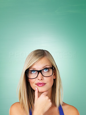 Buy stock photo Pretty woman in glasses looking up at copyspace