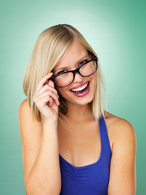 Buy stock photo Cheerful woman holding glasses on green background