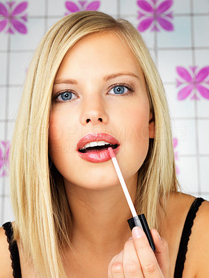 Buy stock photo Closeup of woman putting on lip gloss