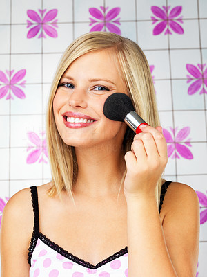 Buy stock photo Pretty blonde woman applying blush indoors