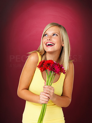 Buy stock photo Attractive blonde holding bouquet of flowers