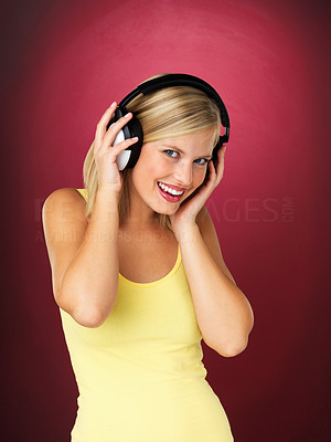 Buy stock photo Pretty blonde woman headphones on against red background