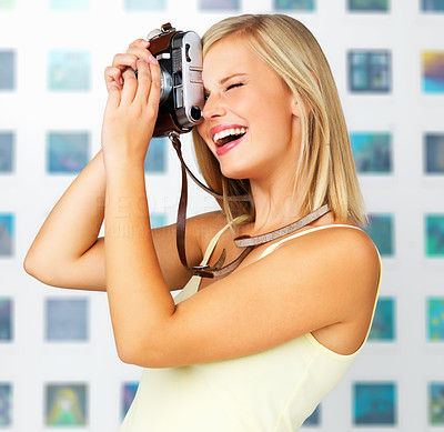 Buy stock photo Side view of happy woman taking photo with vintage camera
