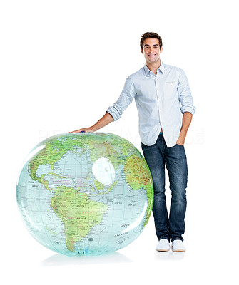 Buy stock photo Portrait of a handsome young boy standing by a globe over white background