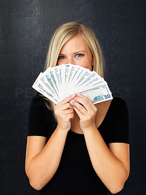 Buy stock photo Pretty blonde woman holding fan made of American money