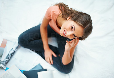 Buy stock photo Top view of happy female student on her mobile phone