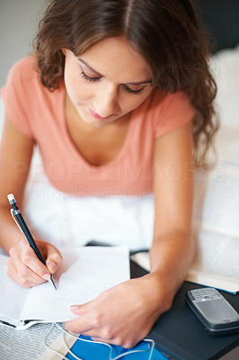 Buy stock photo Girl concentrating on her school work
