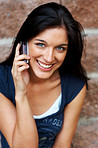 An attractive young girl talkng on mobile phone