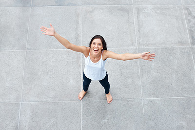 Buy stock photo Top view of an excited young female enjoying her independence with raised hands