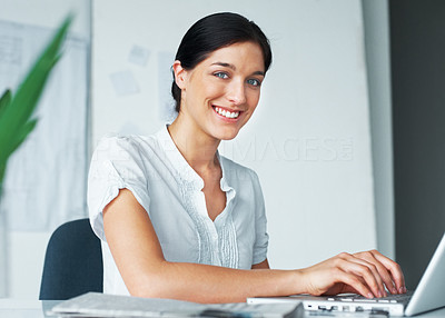 Buy stock photo Portrait of a smiling young business woman using laptop in the office