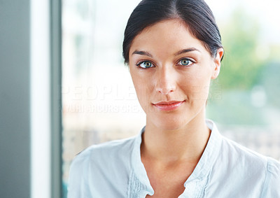 Buy stock photo Closeup portrait of a pretty young woman looking at you with an attitude