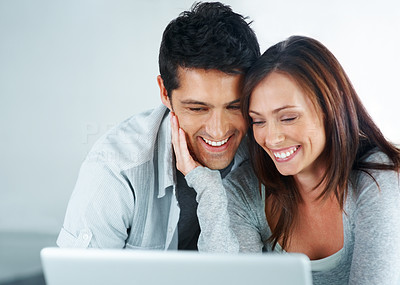Buy stock photo Portarit of a cute young couple using laptop together