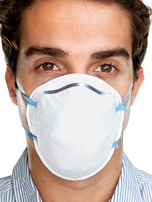 Buy stock photo Closeup portrait of a young guy wearing a surgical mask against white background