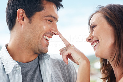 Buy stock photo Closeup portrait of a happy young couple having fun together - Outdoor