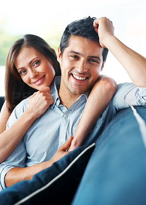 Buy stock photo Portrait of a smiling young couple relaxing on sofa at home - Indoor
