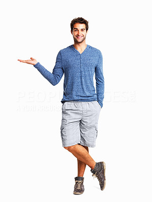 Buy stock photo Full length of a happy man with an invisible product on white background