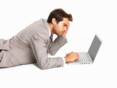 Buy stock photo Serious business man using laptop on white background