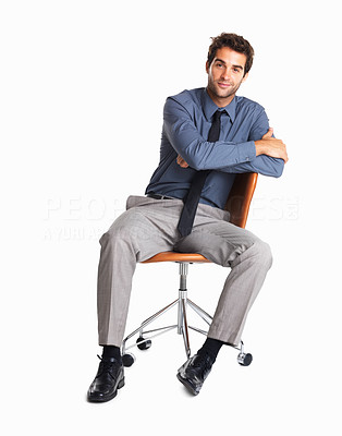 Buy stock photo Shot of a businessman sitting in a chair