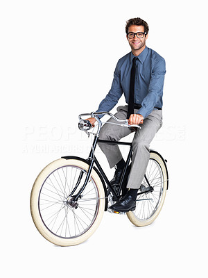 Buy stock photo Studio shot of a businessman riding an old bicycle
