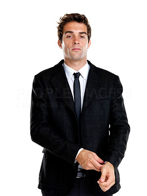 Buy stock photo Portrait of a confident young businessman adjusting his suit against white background