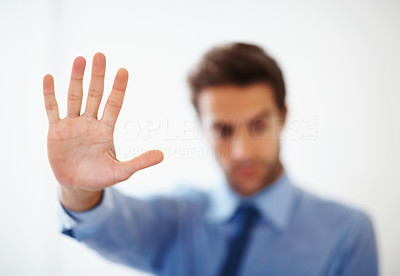 Buy stock photo Business man showing stop gesture
