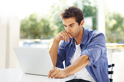 Buy stock photo Portrait of a young guy thinking while working on laptop - Copyspace