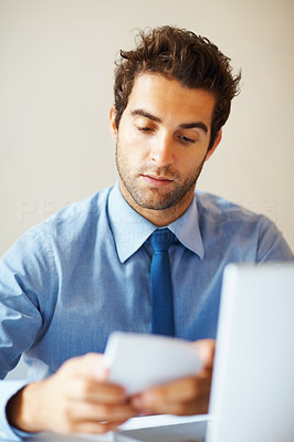 Buy stock photo View of executive working in front of laptop