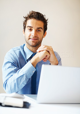 Buy stock photo Executive listening while sitting in front of laptop
