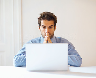 Buy stock photo Serious executive with hands to face, looking at laptop