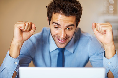 Buy stock photo Happy executive raising fists in excitement, in front of laptop
