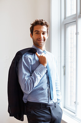 Buy stock photo Smiling executive standing relaxed with jacket over shoulder