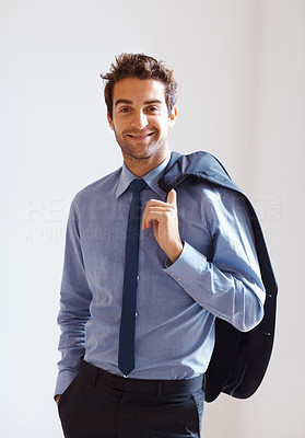 Buy stock photo Happy executive casually standing with jacket over shoulder